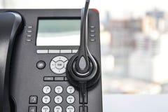 Κάσκα και το τηλέφωνο IP Στοκ εικόνες με δικαίωμα ελεύθερης χρήσης