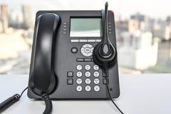 Κάσκα και το τηλέφωνο IP Στοκ Φωτογραφίες