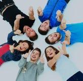 κάτω από να βρεθεί οι νεολαίες αντίχειρων σημαδιών ανθρώπων επάνω Στοκ Φωτογραφίες