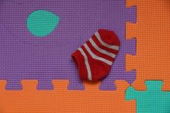 Κάλτσα στο πάτωμα Στοκ Εικόνες