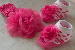 Κάλτσες μωρών με τα σημεία Πόλκα  λουλούδι Στοκ φωτογραφία με δικαίωμα ελεύθερης χρήσης