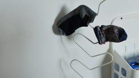 Κάλτσες σε μια κρεμάστρα απόθεμα βίντεο