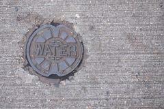 Κάλυψη χρησιμότητας νερού Στοκ Φωτογραφίες