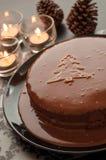 Κέικ γλυκιάς σοκολάτας που θέτουν για τα Χριστούγεννα στο dar Στοκ Φωτογραφία