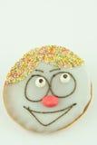 Κέικ με το χρωματισμένο πρόσωπο Στοκ Εικόνα