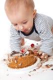 κέικ μωρών που τρώει αστεί&omicro Στοκ Φωτογραφία