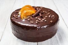 Κέικ σοκολάτας με τα γλασαρισμένα πορτοκάλια, κέικ σοκολάτας με μια περικοπή pi Στοκ εικόνες με δικαίωμα ελεύθερης χρήσης