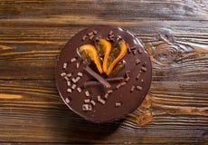 Κέικ σοκολάτας με τα γλασαρισμένα πορτοκάλια, κέικ σοκολάτας με μια περικοπή pi Στοκ Εικόνες