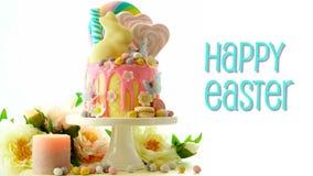 Κέικ σταλαγματιάς Πάσχας candyland με το λαγουδάκι σοκολάτας και το ζωντανεψοντα χαιρετισμό κειμένων φιλμ μικρού μήκους