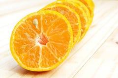 Κέντρο (επιλεγμένη εστίαση) του πορτοκαλιού μισού που είναι το πρώτο του lin Στοκ Φωτογραφίες