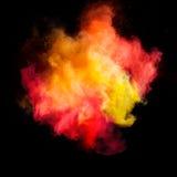 Κίνηση παγώματος της χρωματισμένης έκρηξης σκόνης Στοκ Εικόνα
