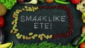 Κίνηση στάσεων φρούτων αφρικανολλανδικής Smaaklike ete, σε αγγλικό Bon appetit στοκ εικόνες