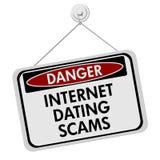 Κίνδυνοι Διαδικτύου που χρονολογεί το σημάδι απατών Στοκ Φωτογραφίες