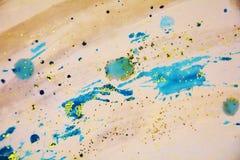 Κίτρινα πορτοκαλιά μπλε φωσφορίζοντα τυχαία κτυπήματα σπινθηρίσματος, κέρινο υπόβαθρο, δημιουργικό σχέδιο Στοκ Εικόνες