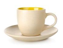 Κίτρινα φλυτζάνι και πιατάκι Στοκ εικόνες με δικαίωμα ελεύθερης χρήσης