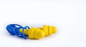 Κίτρινα earplugs με την μπλε ζώνη στοκ φωτογραφία