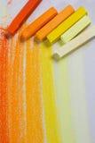 Κίτρινες και πορτοκαλιές κρητιδογραφίες Στοκ Φωτογραφίες