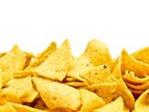 Κίτρινες τροφές χωρίς θρεπτική αξία στο λευκό Στοκ Φωτογραφία