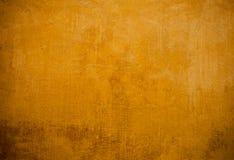 Κίτρινη ανασκόπηση τοίχων Στοκ Φωτογραφίες