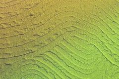 Κίτρινη βρώμικη κυματισμένη κάλυψη στη σύσταση τοίχων - φανταστικό αφ στοκ εικόνες