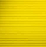 Κίτρινη ευθυγραμμισμένη κενό σελίδα εγγράφου σημειωματάριων Στοκ Φωτογραφία