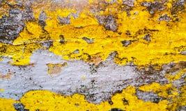 Κίτρινη και γκρίζα σύσταση ενός υποβάθρου grunge μεγάλη σύσταση Χρήσιμος ως σκηνικό στοκ φωτογραφία με δικαίωμα ελεύθερης χρήσης