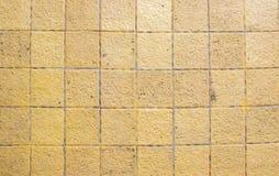 Κίτρινη κεραμική σύσταση κεραμιδιών πατωμάτων Στοκ φωτογραφία με δικαίωμα ελεύθερης χρήσης