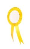 Κίτρινη κορδέλλα βραβείων υφάσματος που απομονώνεται στο λευκό στοκ εικόνες