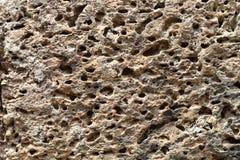 Κίτρινη πορώδης φωτογραφία σύστασης πετρών φυσική πέτρα ανασκόπησης Ξεπερασμένη ανακούφιση βράχου Παλαιά πέτρα grunge Στοκ Εικόνα