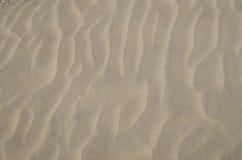 Κίτρινη σύσταση άμμου για το υπόβαθρο Στοκ φωτογραφία με δικαίωμα ελεύθερης χρήσης