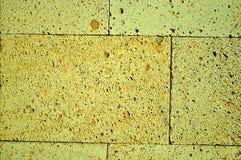 Κίτρινη σύσταση υποβάθρου τουβλότοιχος Στοκ Εικόνες