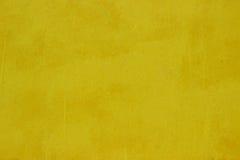 Κίτρινη σύσταση υποβάθρου του σκυροδέματος τεχνητός μπλε ελαφρύς τοίχος πετρών Στοκ Εικόνες