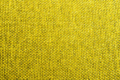 Κίτρινη φωτογραφία κινηματογραφήσεων σε πρώτο πλάνο σύστασης υφάσματος Στοκ φωτογραφία με δικαίωμα ελεύθερης χρήσης