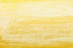 Κίτρινη χρυσή αφηρημένη ζωγραφική watercolor κατασκευασμένη στο υπόβαθρο της Λευκής Βίβλου Στοκ εικόνα με δικαίωμα ελεύθερης χρήσης