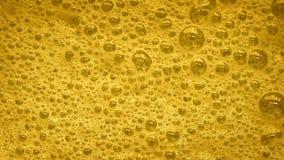 Κίτρινος αφρός με το σκάσιμο φυσαλίδων φιλμ μικρού μήκους