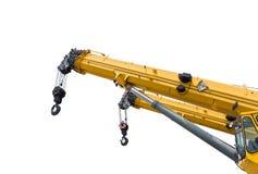 Κίτρινος βραχίονας γερανών με τους γάντζους που απομονώνεται σε ένα άσπρο υπόβαθρο με στοκ φωτογραφία με δικαίωμα ελεύθερης χρήσης