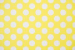 Κίτρινος τοίχος και άσπρα σημεία Πόλκα Στοκ Εικόνες