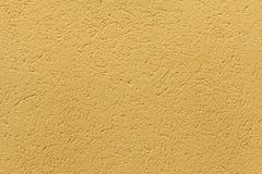 Κίτρινος χρωματισμένος ochre τοίχος στόκων Στοκ φωτογραφία με δικαίωμα ελεύθερης χρήσης