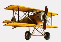 Κίτρινο αεροπλάνο παιχνιδιών που απομονώνονται, άσπρο υπόβαθρο στοκ εικόνα