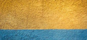 Κίτρινο και μπλε υπόβαθρο εμβλημάτων τοίχων Στοκ φωτογραφίες με δικαίωμα ελεύθερης χρήσης