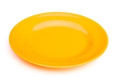 Κίτρινο κενό πιάτο Στοκ φωτογραφία με δικαίωμα ελεύθερης χρήσης