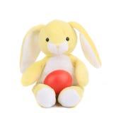 Κίτρινο κουνέλι παιχνιδιών με το αυγό Πάσχας. Στοκ Εικόνα