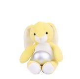Κίτρινο κουνέλι παιχνιδιών Πάσχας με το ασημένιο αυγό Στοκ εικόνα με δικαίωμα ελεύθερης χρήσης