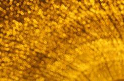 Κίτρινο ονειροπόλο αφηρημένο υπόβαθρο του bokeh από το φως των οδηγήσεων Στοκ Εικόνες