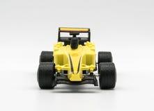 Κίτρινο παιχνίδι ως αυτοκίνητο τύπου που απομονώνεται στο λευκό Στοκ Εικόνα