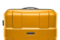 Κίτρινο σκοτεινό πλαστικό βαλιτσών ανώτερο μέρος της λαβής Στοκ Φωτογραφίες