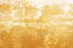 Κίτρινο υπόβαθρο τοίχων τσιμέντου grunge Στοκ Φωτογραφίες