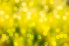 Κίτρινο υπόβαθρο bokeh και θαμπάδων Στοκ Φωτογραφία