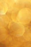 Κίτρινο χρυσό υπόβαθρο θαμπάδων - φωτογραφίες αποθεμάτων Χριστουγέννων Στοκ εικόνα με δικαίωμα ελεύθερης χρήσης