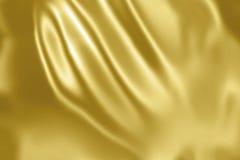 Κίτρινο χρυσό υπόβαθρο σατέν υφάσματος Στοκ Εικόνες